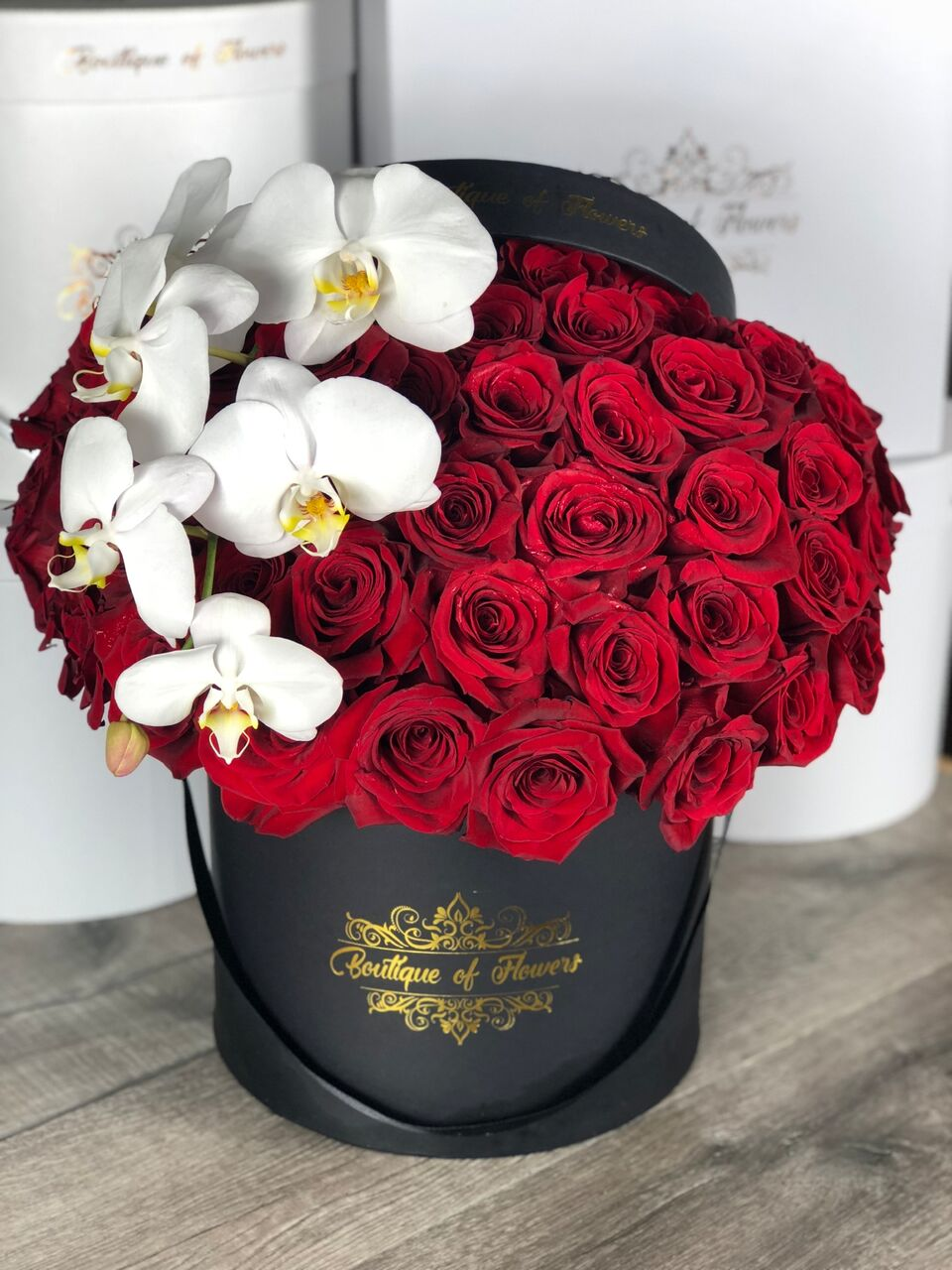 50 red rose with orchid round box